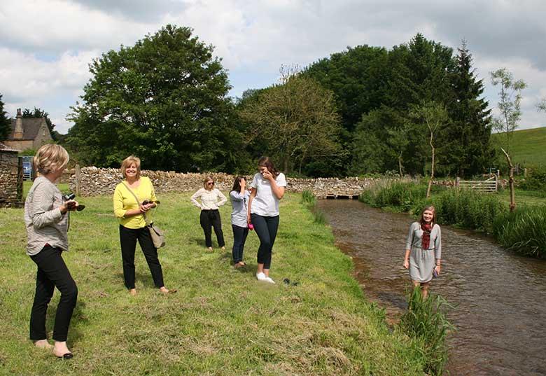 Ladies having fun in the river at Naunton Dovecote