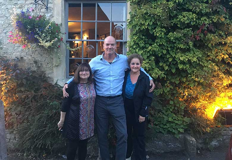 Rita and Annette with Chris outside The Castle Inn, Castle Combe