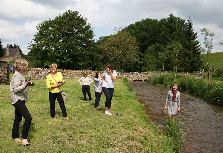 Ladies having fun in the river at Naunton Dovecote