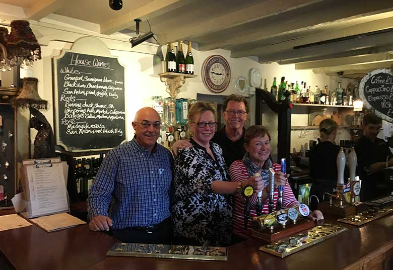 Cheryl and friends 'pulling a pint' at the Kings Arms, Mickleton